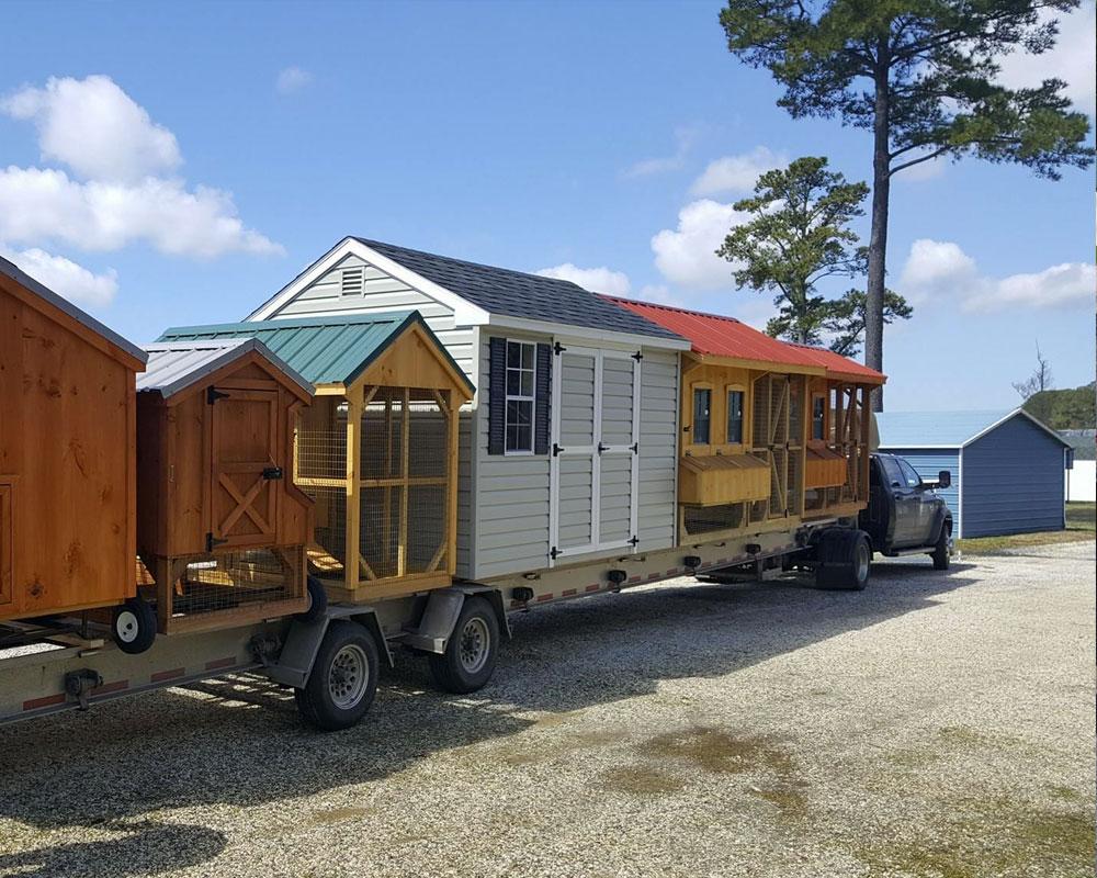 truck delivering sheds